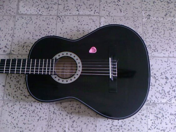 * ThE mAgIc Of My BlAcK gUiTaR *