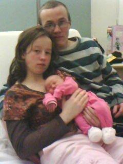 mon ange avec sa maman et son papa