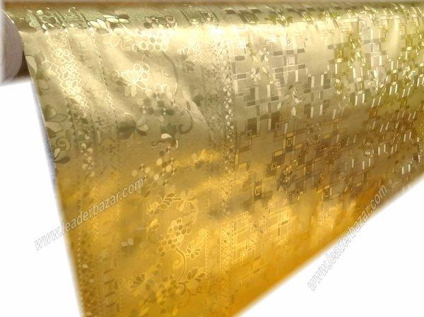 Toile cirée dorée en 1.38m. de largeur.à la coupe