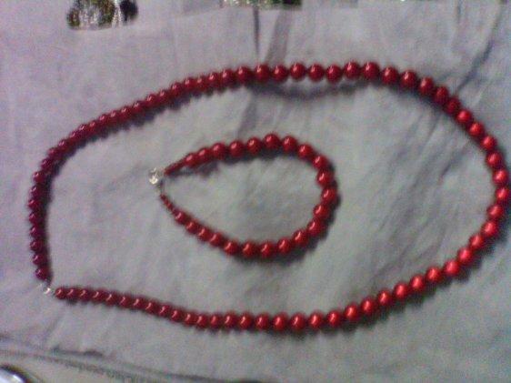 Bracelet et collier perles magique rouge