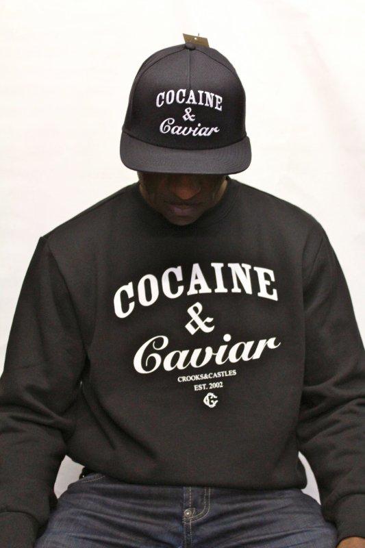 Voilà le pull de la marque Crooks and Castles, Cocaine et Caviar qui fait fureur en ce moment