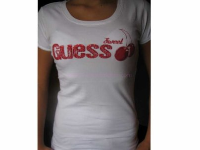 Tee shirt guess Taille M .
