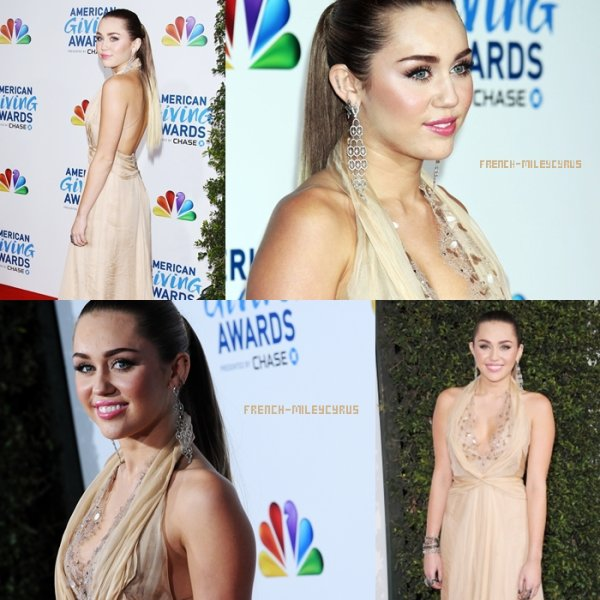 MILEY AUX AMERICAN GIVING AWARDS - TAPIS ROUGE À LOS ANGELES - LE 9 DÉCEMBRE 2011