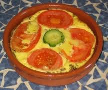 Entrée: Flan à la tomate et aux courgettes