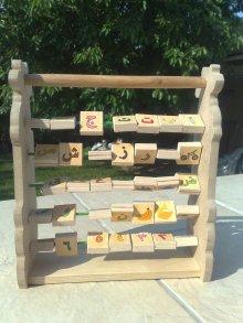 JEUX EDUCATIFen bois modulable avec les lettres de l'alphabet en arabe et les chiffres