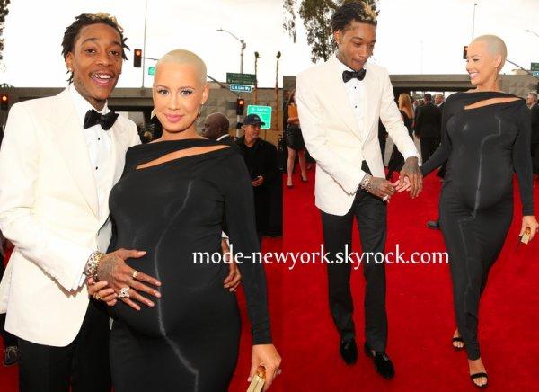 Wiz Khalifa et Amber, notre belle diva a montré son ventre rond dans une robe noire de chez Donna Karan.