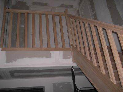 le haut de l'escalier avec la renbare