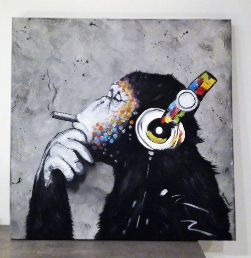 Le Singe Mélomane, fumant un cigare...