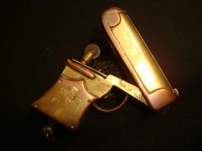Briquet en forme de pistolet