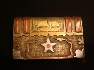 Briquet livre cuivre et laiton avec étoile en aluminium