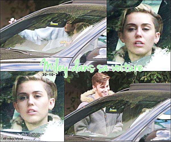 Miley posant avec un fan - 30 octobre 2013