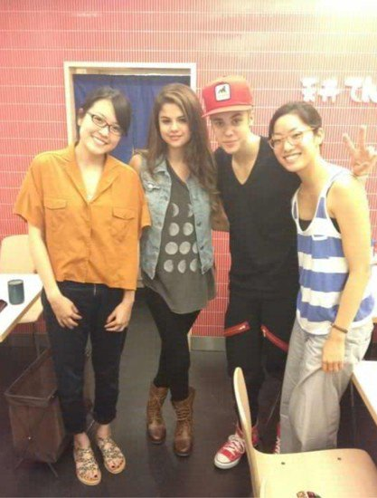 Justin and Selena with fans in Japan.