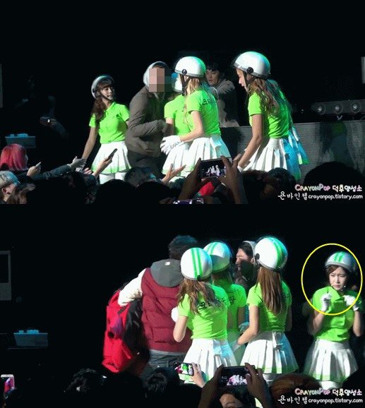 Un fan du groupe féminin Crayon Pop est monté sur scène pour enlacer une des membres.