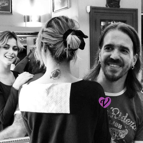 Le nouveau tatouage de Tini & Juntada Tinista