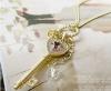 collier/ sautoir doré  clé rose