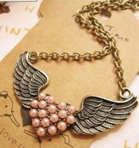 Collier coeur perles