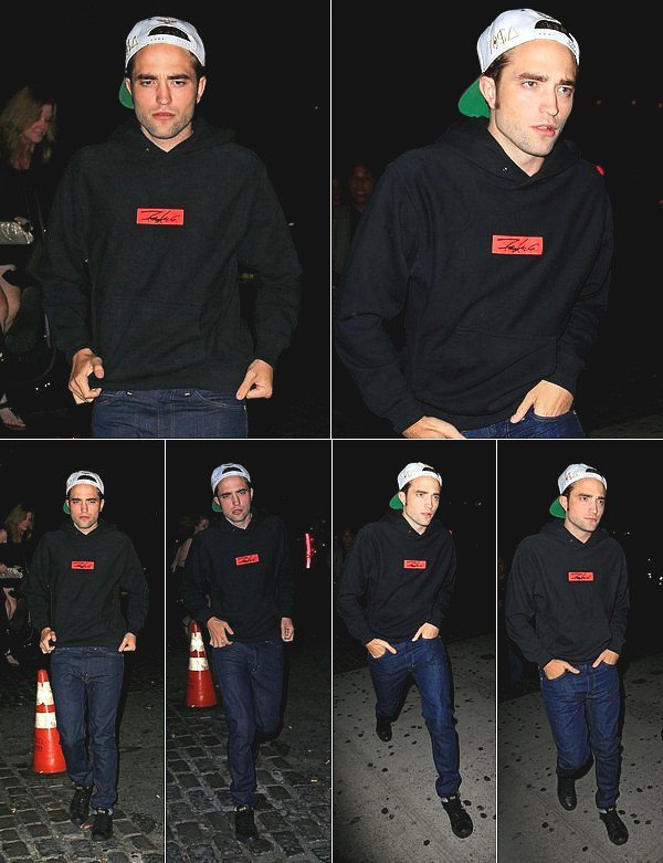 . Robert sortant de son hôtel à New York le 14 août, casquette à l'envers et gros pull.