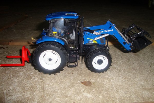 new holland T6020 + pique boulle
