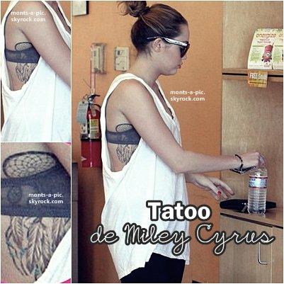 Voila de plus proche son tatoo !