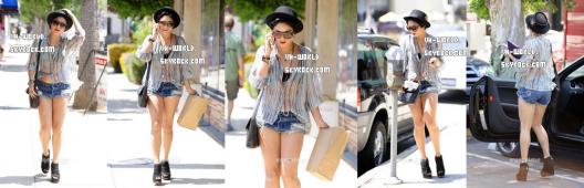 Le 10/08/2011.Nessa dans Hollywood faisant du shopping !. A votre avis,à qui téléphone-t-elle ?
