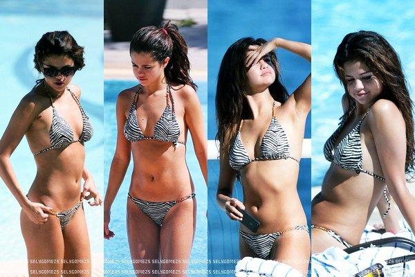 28 Octobre 2013 - Au bord de la piscine de son hôtel à Miami, Floride.