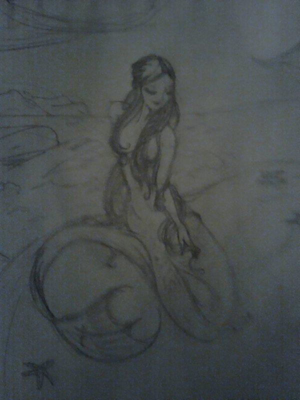 Sirène se prélassant sur son rocher