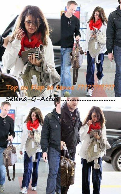 Le 13/03/2011 à l'aéroport de L.A avec son beau père .