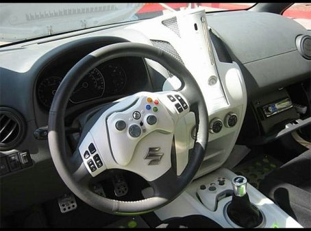 manette de xbox sur volant de voiture salut. Black Bedroom Furniture Sets. Home Design Ideas