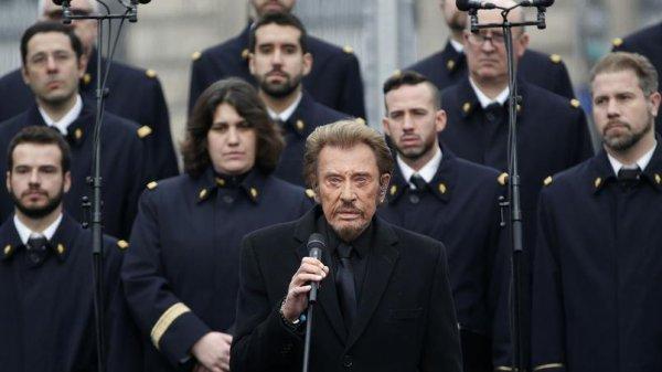 Johnny HALLYDAY à la Bourse pour rendre hommage aux victimes du 22 mars...