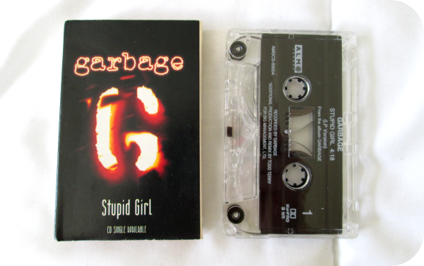 "Supports single ""Stupid girl"" (1996)"