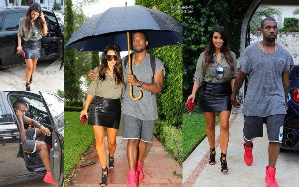 kim kardashian et son petit ami kanye west aper u sous la pluie dans les rues de miami lundi. Black Bedroom Furniture Sets. Home Design Ideas