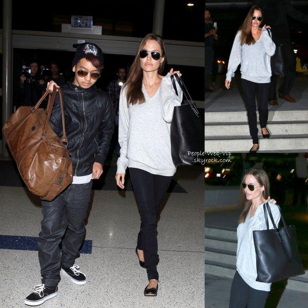 Angelina Jolie aperçue accompagnée de son fils de 12 ans, Maddox, à l'aéroport de LAX   ( Février 14) à Los Angeles)