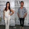 """Kourtney Kardashian et Scott Disick se sont rendus au """"Women's Health's Party Under the Stars"""". Pour l'occasion, la jolie maman enceinte a montré son baby bump vêtue d'une combinaison bien moulante.  (samedi (9 Août) à Bridgehampton, NY )"""