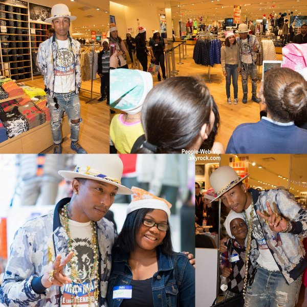 "Pharrell Williams pose pour quelques photos avec des fans alors qu'il assistait à l'événement ""Uniqlo Charity Shopping""  tenue au Beverly Center au magasin Uniqlo ( mardi (9 Décembre) à Los Angeles.)"