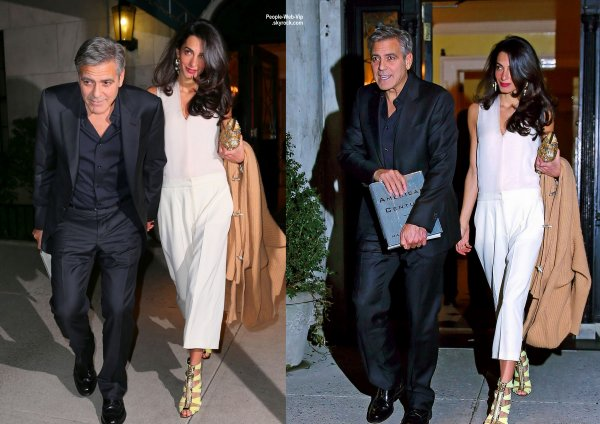 George Clooney et sa femme Amal se tiennent la main en sortant d'une résidence privée après un dîner en amoureux. (vendredi (27 Mars) à New York City.)