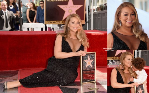 Mariah Carey, heureuse, poant avecson étoile sur le Hollywood Walk of Fame. L'artiste a été rejoint à la cérémonie par ses jumeaux Moroccan et Monroe. (mercredi (5 Août) à Hollywood.)