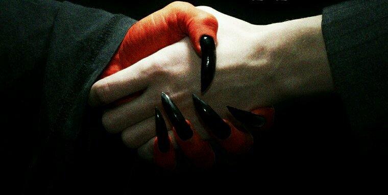 Between the hands of the Devil