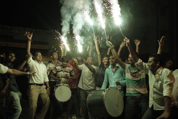 Indian cricket fans light crackers as they celebrate Indian team's victory against Pakistan in Sunday's ICC Twenty20 Cricket World Cup match against Pakistan in Ahmadabad.