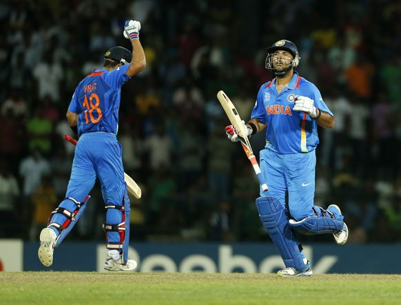 India's batsmen Virat Kohli, left, and Yuvraj Singh celebrate the victory over Pakistan by 8 wickets in the ICC Twenty20 Cricket World Cup Super Eight match between India and Pakistan in Colombo.