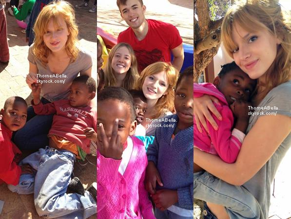 Bella , Remy et Bella P. visitant un petit village d'Afrique le 24 juin 2013 .