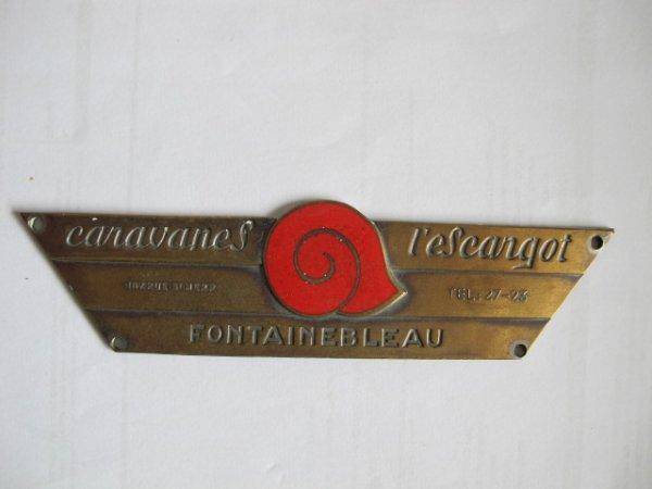 Quelques badges (trophé ou publicitaire)