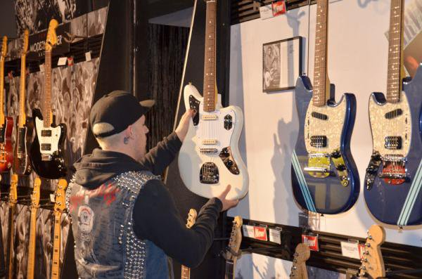 Joel Madden checks out new @Johnny_Marr Jaguar at Fender Showcase