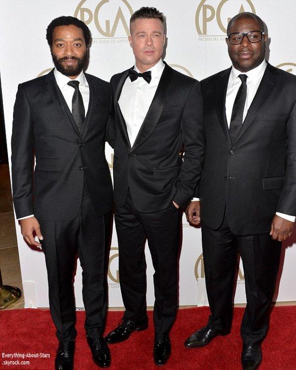 19/01/14: Brad Pitt, Chiwetel Ejiofor et Steve McQueen sur le tapis rouge de la cérémonie des  Producers Guild Of America Awards à Beverly Hills