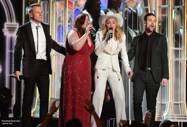 GRAMMY AWARDS 2014: Cérémonie, Red Carpet, Palmarés, Récompense et Vidéos  Macklemore et Ryan Lewis : le duo célèbre 33 mariages hétérosexuel et homosexuel en direct. Pour l'occasion, le duo américain était accompagné sur scène de Madonna, de Mary Lambert et de Queen Latifah