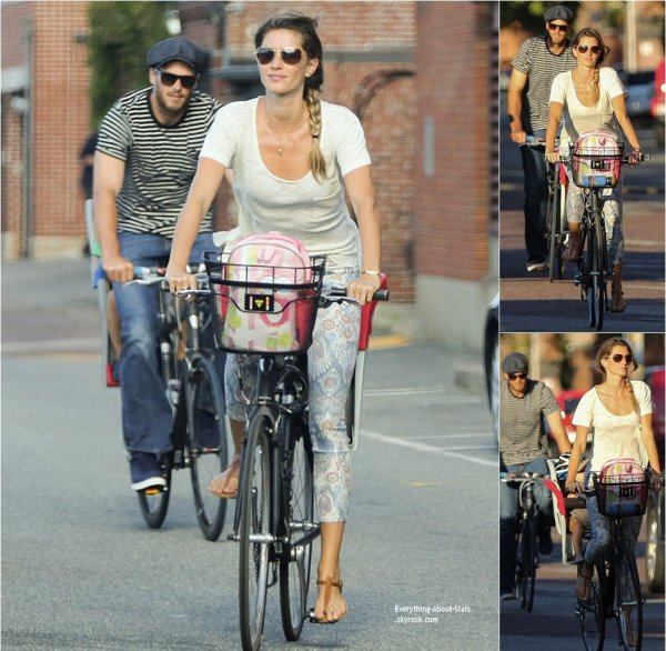 30/08/14: Gisele Bundchen repérée avec son mari Tom Brady à vélo dans les rues de Boston