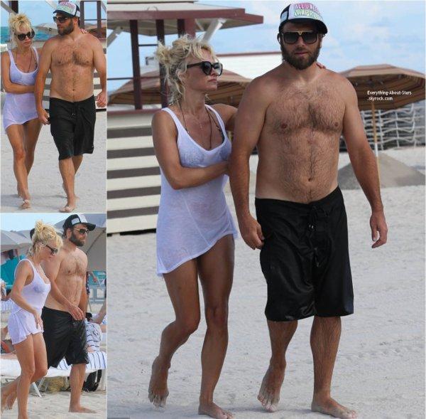 06/09/14: Pamela Anderson photographié avec son husband Rick Salomon sur une plage de Miami