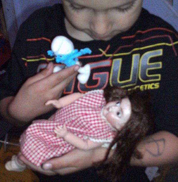 petite poupée ancienne 27cm marqué d'une ancre marine