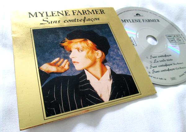 "CD Maxi Promo OR ""Sans contrefaçon"""