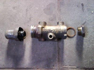 Répartiteur de pression d'huile de freins