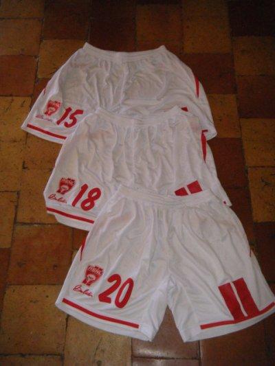 Trois shorts portés en coupe d'Europe avec Nancy par Hadji (15), Chrétien (n20) et Feret (n18).